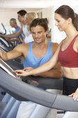 Woman Working With Personal Trainer On Running Machine In Gym — Stock Photo