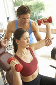 Young Woman Working With Weights In Gym With Personal Trainer — Stock Photo