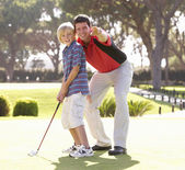 Father Teaching Son To Play Golf On Putting On Green — Stock Photo