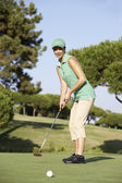 Female Golfer On Golf Course Putting On Green — Stock Photo