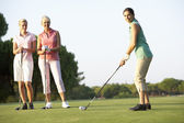 Group Of Female Golfers Teeing Off On Golf Course — Stock Photo
