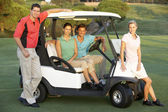 Group Of Friends Riding In Golf Buggy On Golf Course — Stock Photo