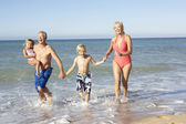 Grandparents With Grandchildren Enjoying Beach Holiday Together — Stock Photo