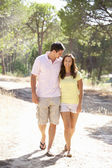 Young couple, holding hands, walking,walk in park — Stock Photo