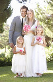 Bride And Groom With Bridesmaid At Wedding — Stock Photo