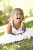 Young girl posing in park — Stock Photo
