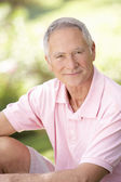Senior man relaxing in a park — Stock Photo
