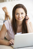 Young woman on her laptop computer — Stock Photo