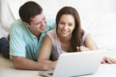 Young couple on laptop computer — Stock Photo