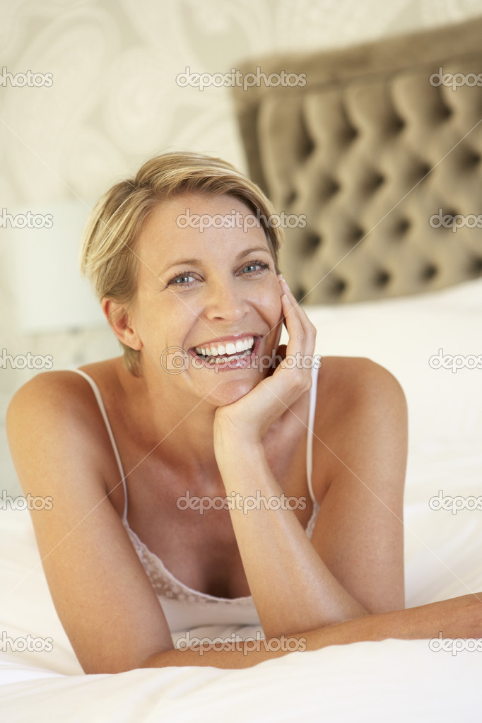 Young Woman Relaxing In Bedroom — Stock Photo #4840136