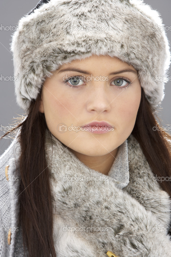 Young Woman Wearing Warm Winter Clothes And Fur Hat  In Stu — Stock Photo #4840506