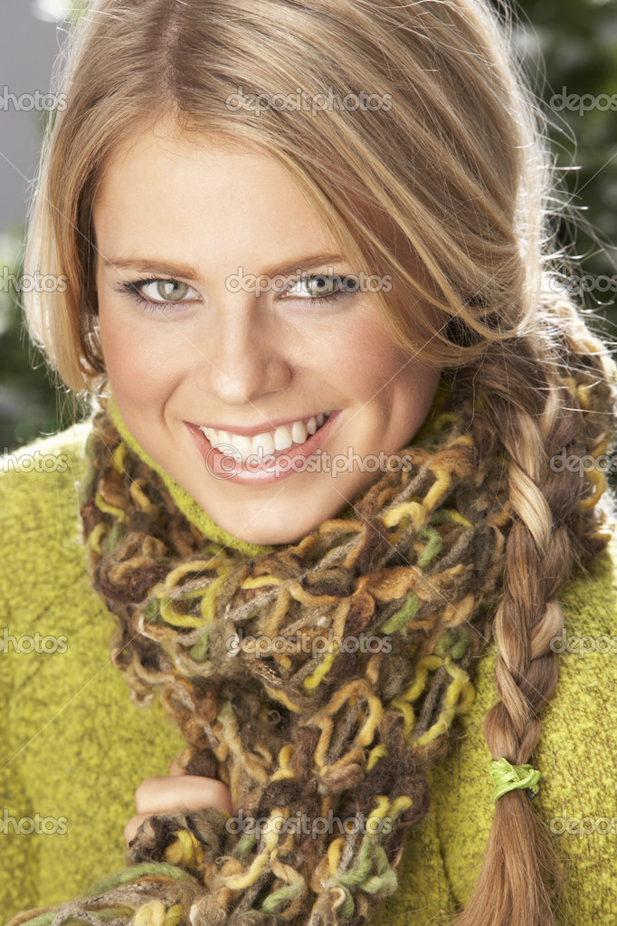Fashionable Woman Wearing Knitwear And Scarf In Studio In Front Of Christmas Tree — Stock Photo #4840635