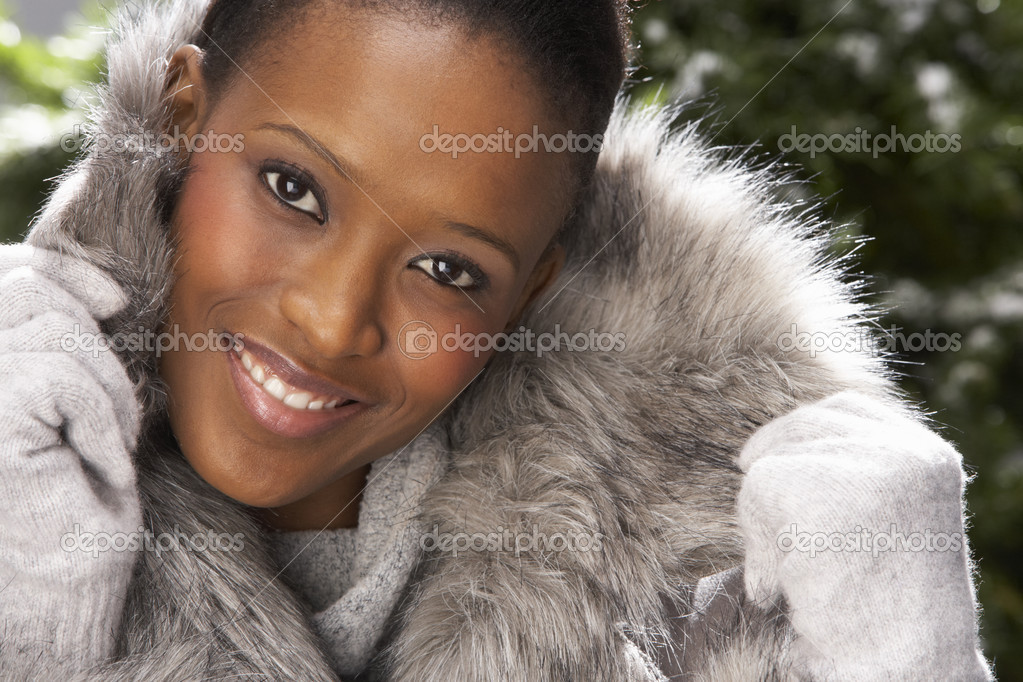 Fashionable Woman Wearing Fur Coat In Studio In Front Of Christmas Tree — Stock Photo #4840650