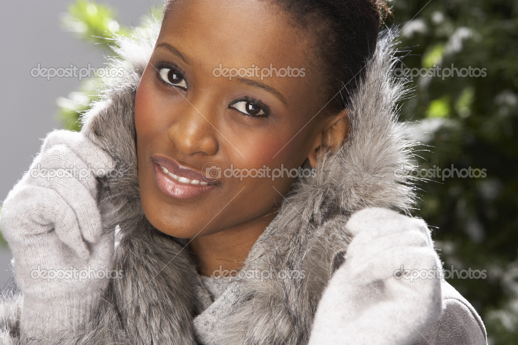 Fashionable Woman Wearing Fur Coat In Studio In Front Of Christmas Tree  Stock Photo #4840652