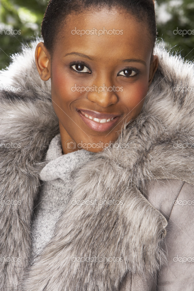 Fashionable Woman Wearing Fur Coat In Studio In Front Of Christmas Tree — Stock Photo #4840654