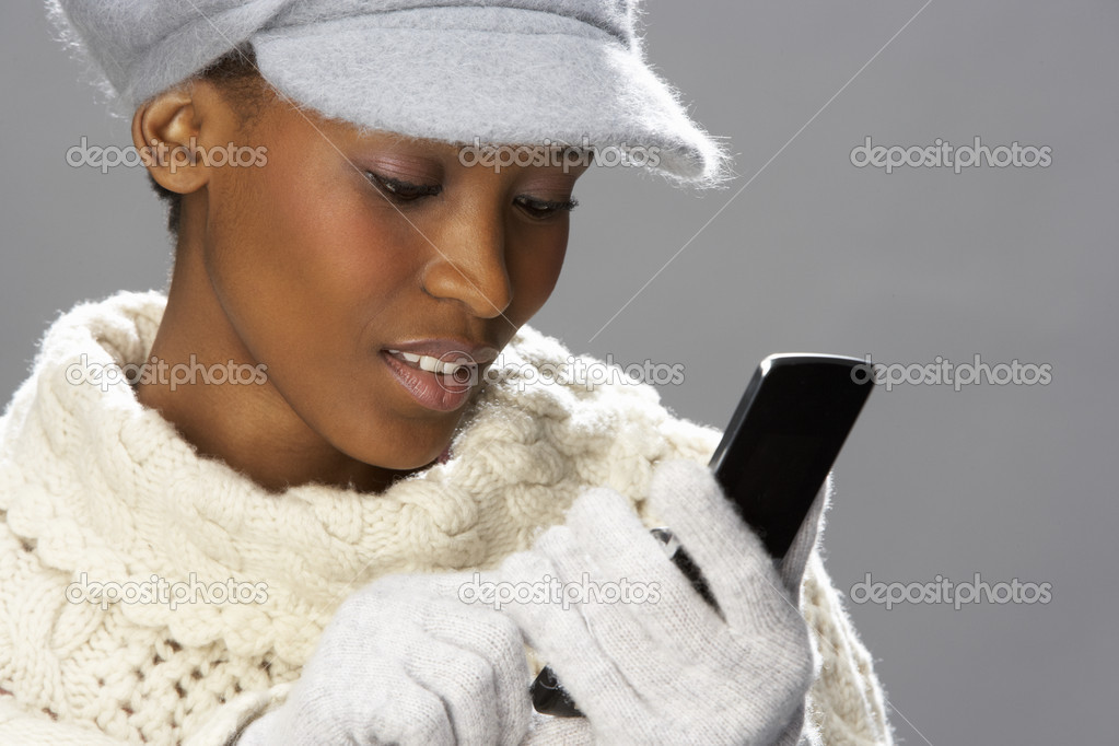 Fashionable Woman Wearing Knitwear And Cap In Studio In Front Of Christmas Tree — Stock Photo #4840727