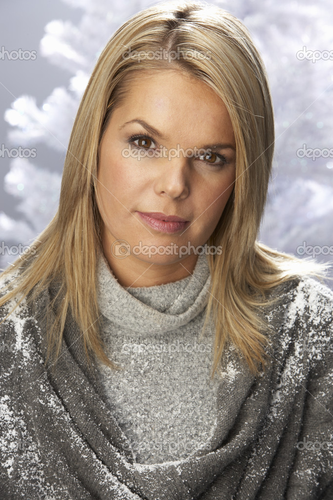 Fashionable Woman Wearing Knitwear In Studio In Front Of Christmas Tree — Stock Photo #4840766