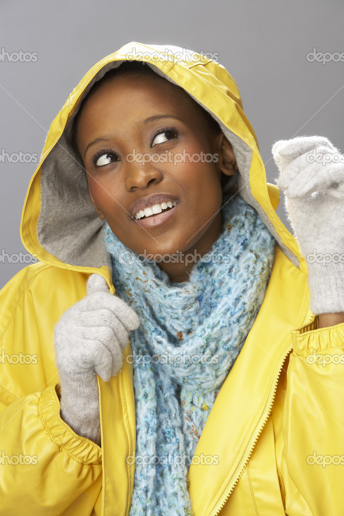Young Woman Wearing Yellow Raincoat In Studio — Stock Photo #4840773
