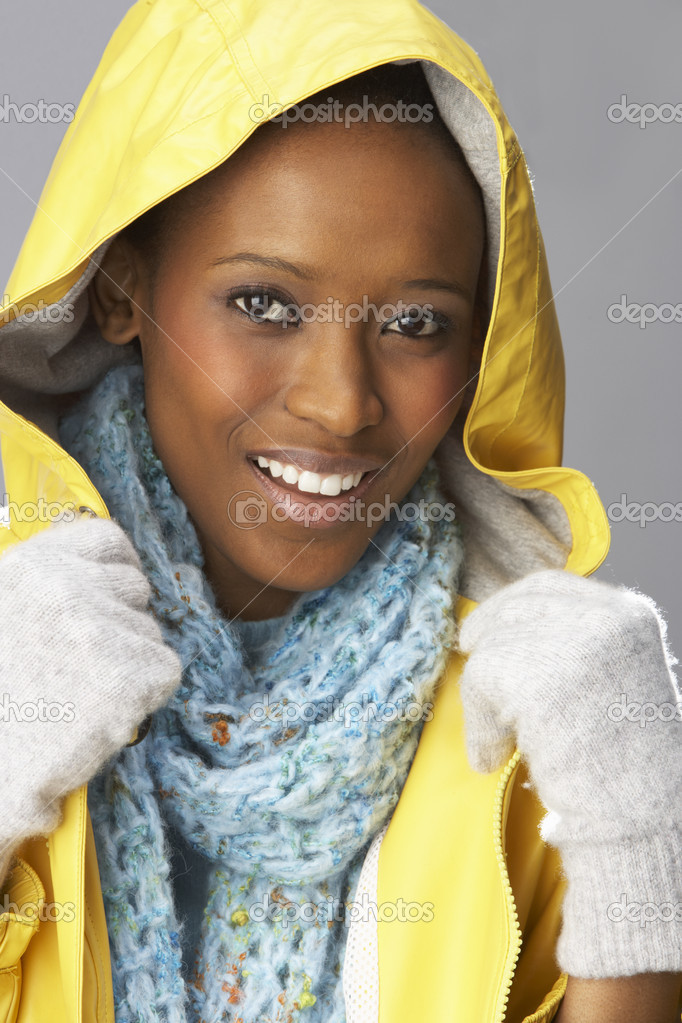 Young Woman Drinking Hot Drink Wearing Yellow Raincaot — Stock Photo #4840779