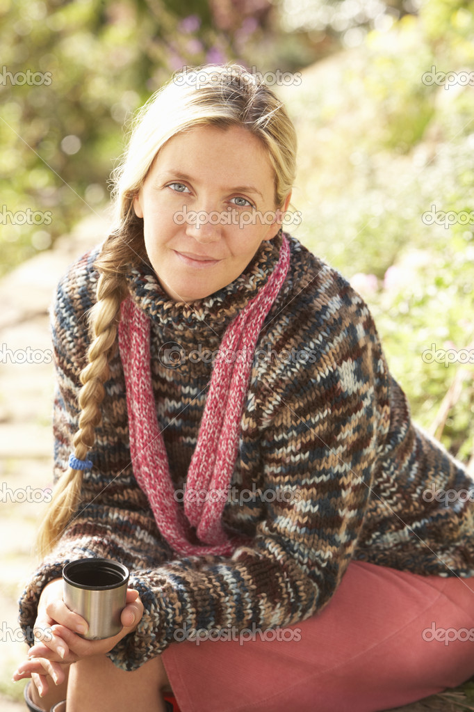 Young Woman Relaxing With Thermos Flask In Autumn Landscape — Stock Photo #4840861
