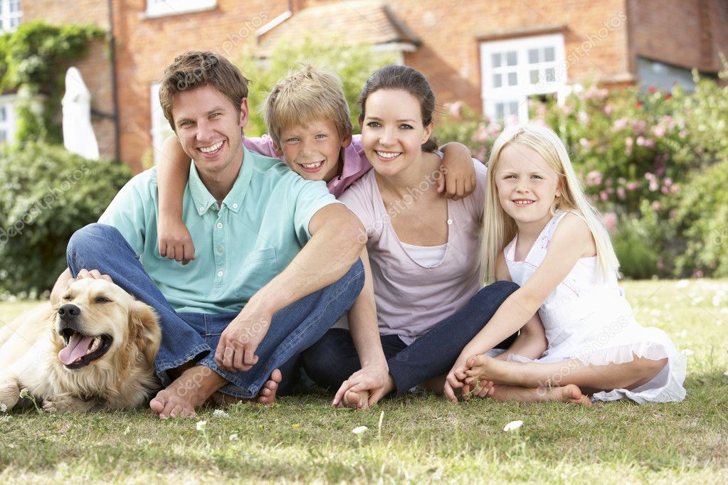 Family Sitting In Garden Together  Stock Photo #4841404