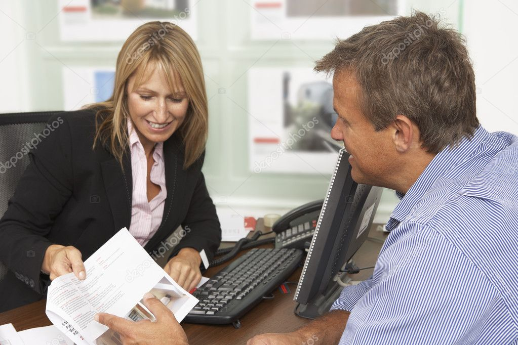 Female Estate Discussing Property Details With Client — Stock Photo #4841426