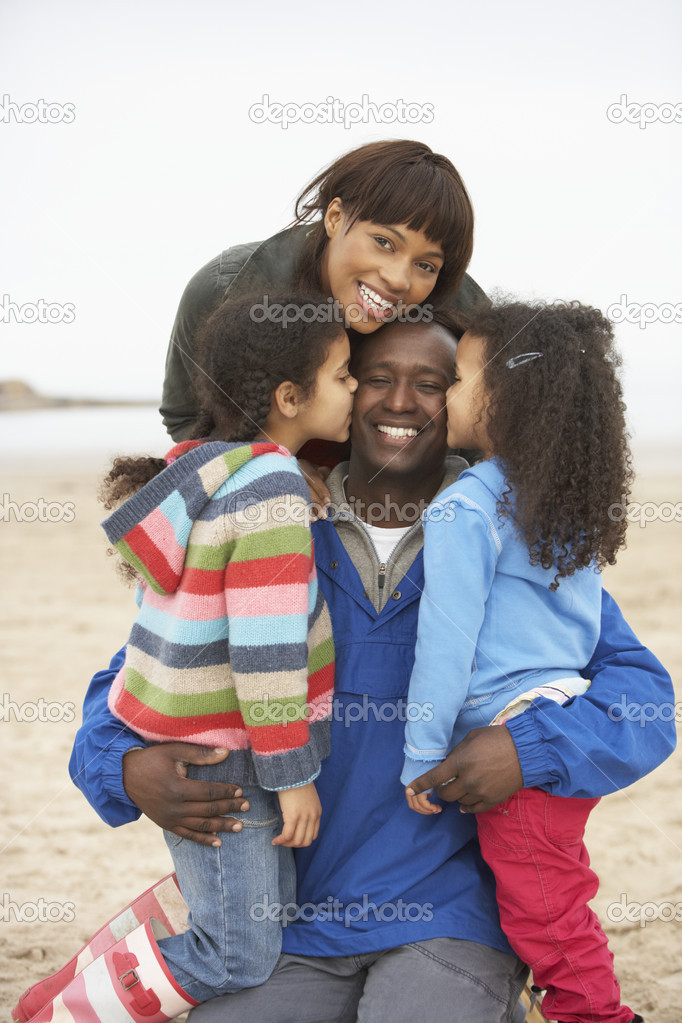 Family Relaxing On Winter Beach Break  Stock Photo #4841751