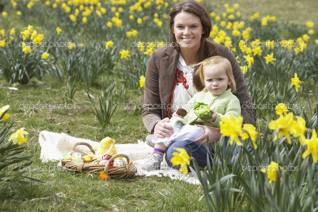 Mother And Daughter In Daffodil Field With Decorated Easter Eggs  Stock Photo #4842065