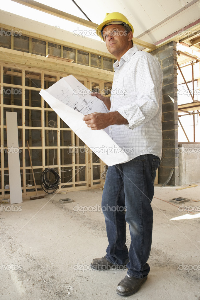 Architect With Plans In New Home  Stock Photo #4842527
