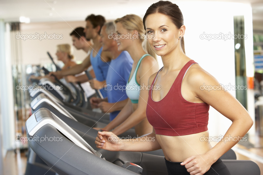 Woman On Running Machine In Gym  Stock Photo #4842981