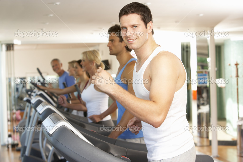 Man On Running Machine In Gym — Stock Photo #4842991