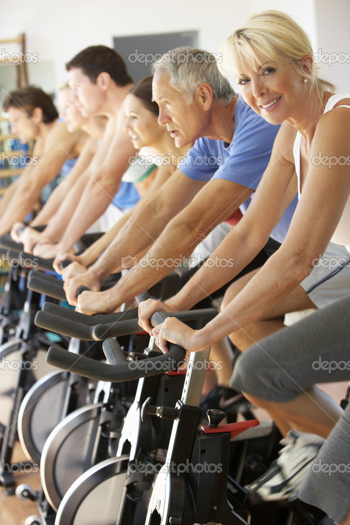 Senior Woman Cycling In Spinning Class In Gym — Stock Photo #4843035