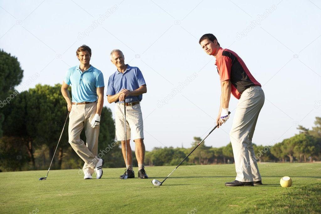 Group Of Male Golfers Teeing Off On Golf Course — Stock Photo #4843121