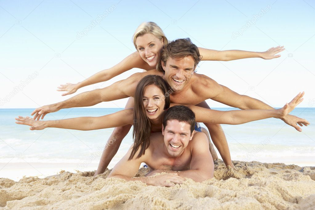 Group Of Friends Enjoying Beach Holiday  Stock Photo #4843251