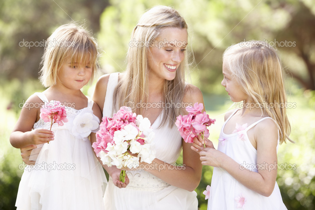 Bride With Bridesmaids Outdoors At Wedding — Photo #4843490
