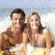 Young couple on beach holiday — Stock Photo