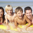 Stock Photo: Young family pose on beach