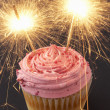 A cupcake with sparklers - Stock Photo