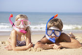 Young children on beach holiday — Stock Photo
