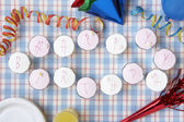 Cupcakes spell out happy birthday — Stock Photo