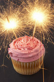 A cupcake with sparklers — Stock Photo