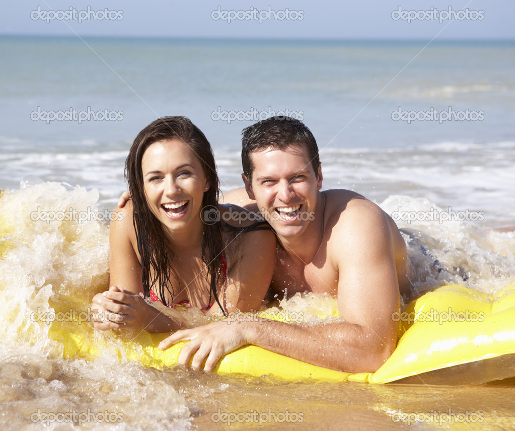 Young couple on beach holiday  Stock Photo #5179468