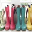 A display of colorful rain boots - Zdjęcie stockowe