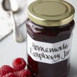 Stock Photo: A still life of raspberry jam in jar
