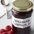Still life of raspberry jam in jar — Stock Photo #5183881