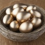 A basket of golden eggs — Stock Photo