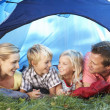Stock Photo: Young family poses in tent