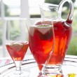 Fruit drink in a decanter and glasses — ストック写真