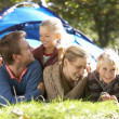 Young family poses outside of tent — Foto Stock