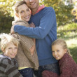 Young family pose in park — Stock Photo #5189998